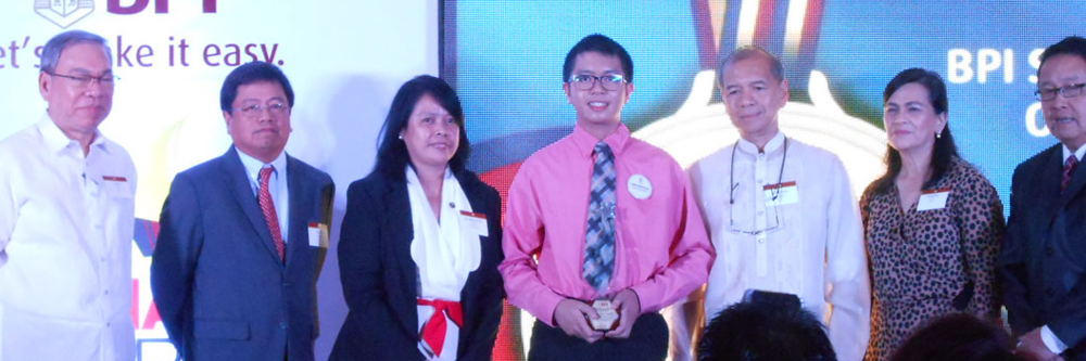 NCPAG Student Emir Mendoza receives the 2013 Outstanding Pinoy Expat Children Award